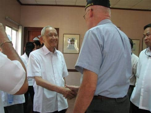 Before ceremony: Greeting Col. Rafael R. Estrada, Filipino Death March Survivor, Founder, Chairman Emeritus, Defenders of Bataan & Corregidor, Inc.